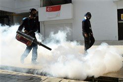 Pest control staff fumigate at the Macpherson housing estate in Singapore on Aug. 31.
