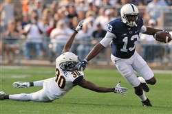 Saeed Blacknell (13) of Penn State avoids a tackle from Darryl Marshall (30) from Kent State Saturday at Beaver Stadium.