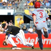 Jordy Mercer forces out the Cardinals' Jedd Gyorko Monday at PNC Park. The Cardinals won, 12-6.