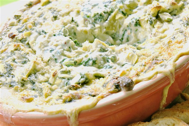 Serve Spinach and Artichoke Dip crostini, toasted pita wedges or bagel chips.