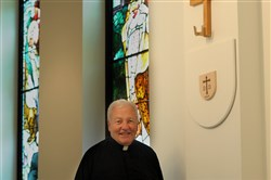 Father Charles Bober in the new sanctuary of St. Kilian Catholic Church in Cranberry.