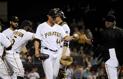 Clint Hurdle relieves Tony Watson after Watson gave up three home runs Sept. 9 against the St. Louis Cardinals at PNC Park.