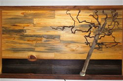 Marland Madera combined a dried piece of a plant known as Harry Lauder walking stick with pallet wood to create a wall hanging. It was a winner in the art category of the 2016 Reuse Inspiration Contest.