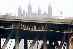 A crew works on Liberty Bridge repairs Thursday after a fire last Friday on the span.