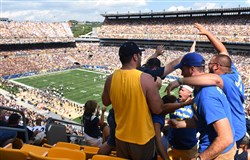 Pitt fans celebrate an interception Saturday in Heinz Field during the Pitt-Penn State game. The Panthers won 42-39.