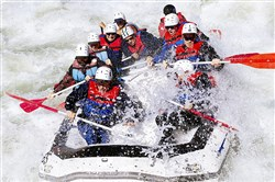 Rafters bust a wave on the Gauley River near Summersville, W.Va.