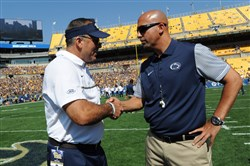 Pitt coach Pat Narduzzi greets Penn State coach James Franklin before Saturday's game at Heinz Field.