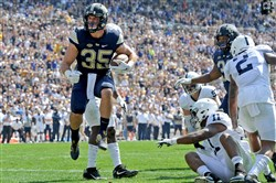Pitt fullbackGeorge Aston scores in the first quarter Saturday against Penn State at Heinz Field.
