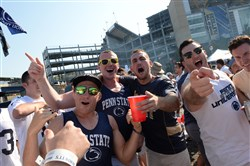 Fans sing as they tailgate before Pitt takes on Penn State Saturday at Heinz Field.