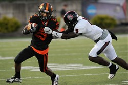 Aliquippa's Kwantel Raines, right, brings down Beaver Falls' Mason Carothers during the WPIAL Class 3A Beaver Valley Conference game on Friday.