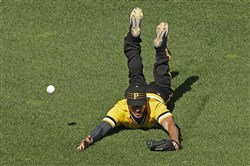 Pirates left fielder Matt Joyce came up short on a dive against the Cincinnati Reds Sept. 11 at PNC Park. Was he just unlucky?