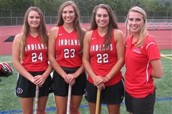 Schratz family sisters, from left, Veronica, Greta, Samara and Courtney fill roles on the Peters Township field hockey team. Courtney is a coach, and the other three sisters are players.