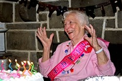 Margaret Opferman reacts at her 100th birthday party in South Park.