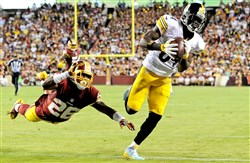 The Steelers' Antonio Brown pulls in a pass for a touchdown against Redskins' Bashaud Breeland in the third quarter Monday at FedEx Field.