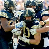 Mike Caprara is congratulated after recovering a fumble against Penn State Sept. 10 at Heinz Field.