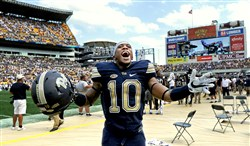 "Pitt's Quadree Henderson celebrates near the end of his team's win over Penn State Saturday at Heinz Field. He said the win was special, ""Just the fact they're Penn State."""