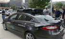 A Ford Fusion outfitted with Uber's self-driving technology was on display at Point State Park in Downtown Pittsburgh in August.