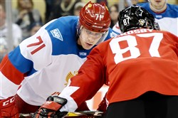 Evgeni Malkin faces off with Sidney Crosby in a World Cup of Hockey exhibition last week at Consol Energy Center.