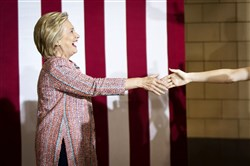 Hillary Clinton greets an attendee Thursday at the University of North Carolina at Greensboro.