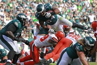 The Eagles' leaps over Cleveland's Christian Kirksey for a touchdown Sunday.