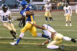 Richard Stone of Brashear tries to stop Genaro Coleman of Westinghouse after Coleman snatched up a Brashear fumble in the end zone Thursday at Cupples Stadium.