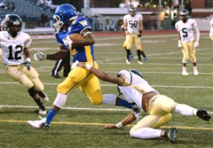 Richard Stone (1) from Brashear tries to stop Genaro Coleman (2) from Westinghouse after Coleman snatched up Brashear's fumbled ball in the end zone at George Cupples Stadium in South Side on Thursday.