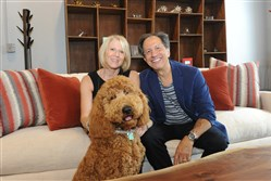 Perry and Lora Sigesmund, owner of Perlora Loft on the South Side with their dog, Copper.