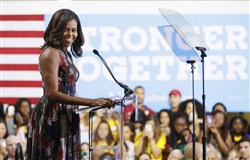 First lady Michelle Obama speaks during a campaign rally in support of Democratic presidential candidate Hillary Clinton at George Mason University in Fairfax, Va.