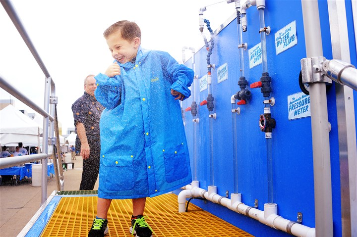 20160917lf-Alcosan01 Liam Richardson, 6, of South Fayette tries out different water switches in the 14th Alcosan Open House at Allegheny County Sanitary Authority on Saturday.