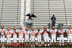 The Penn Hills freshman football team — one of just 18 remaining in the WPIAL — waits for the start of a game earlier this month against Mars at Mars.