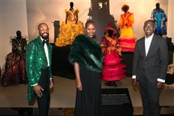 "From left, Darnell McLaurin, Demeatria Boccella and Paul Tazewell pose with the collection at the ""Costumes of The Wiz Live!"" fashion exhibition ppening party on Saturday night at the August Wilson Center for African American Culture, Downtown."