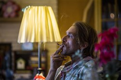 Musician Todd Snider smokes a joint before playing music at his home in Hendersonville, Tenn., near Nashville, on Friday.