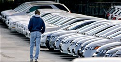 A shopper scans a long line of unsold General Motors lease-return vehicles on the lot of a Pontiac-GMC dealership in Aurora, Colo. The credit approval rate of 57.7 percent for car leases in the month of August was the lowest rate seen in 2016 and the lowest for the month of August in the past two years. By comparison, the approval rate for August 2015 reached 85.7 percent.