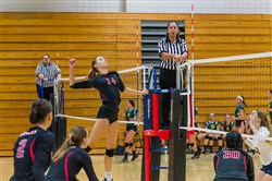 Upper St. Clair junior outside hitter Isabelle Walsh goes up for a kill during the Mt. Lebanon tournament Sept. 3.