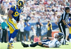 Los Angeles Rams defensive end and Pitt alumnus Aaron Donald stands over Seahawks quarterback Russell Wilson during a game Sunday in Los Angeles.
