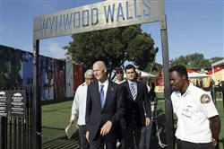 Florida Gov. Rick Scott, center, walks from Wynwood Walls after a news conference Monday in the Wynwood neighborhood of Miami.