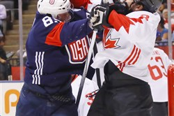 Justin Abdelkader of Team USA, left, battles Canada's Drew Doughty early in a World Cup of Hockey game Tuesday night in Toronto. Canada won, 4-2.