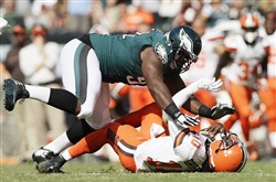Philadelphia Eagles' Fletcher Cox, left, tackles Cleveland Browns' Robert Griffin III during the second half of the teams' game Sept. 11.