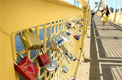 Love locks hang from the Roberto Clemente Bridge on Wednesday in Downtown Pittsburgh.