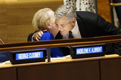 Former Secretary of State Madeleine Albright is greeted by George Clooney at a summit about refugees during the 71st Session of the United Nations General Assembly on Tuesday.