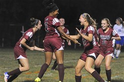 The Oakland Catholic girls soccer team celebrates after Essence Canady scored a goal against South Park Sept. 21 at South Park High School.
