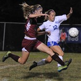 Oakland Catholic's Claudia Lenhart, left, and South Park's Jordyn Minda fight for control of the ball in a Class 3A Section 3 match Wednesday won by Oakland Catholic, 3-1.