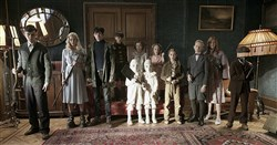 "The residents of Miss Peregrine's Home for Peculiar Children,"" ready themselves for an epic battle against powerful and dark forces. Left to right: Enoch (Finlay Macmillan), Emma (Ella Purnell), Jake (Asa Butterfield), Hugh (Milo Parker), Bronwyn (Pixie Davies), the twins (Thomas and Joseph Odwell), Claire (Raffiella Chapman), Fiona (Georgia Pemberton), Horace (Hayden Keeler-Stone), Olive (Lauren McCrostie), and Millard (Cameron King)."