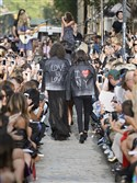 Models walk the streets outside Rebecca Minkoff's Soho store for a runway show during New York Fashion Week in September. The designer was one of the earliest adopters of the see now/buy now trend and reported a 200 percent increase in sales the month she launched her first shoppable collection.