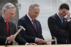 "WASHINGTON, DC - SEPTEMBER 21:  Speaker of the House Paul Ryan, R-Wis., laughs as Sen. Chuck Schumer, D-N.Y., center, and Senate Majority Leader Mitch McConnell drive nails into a piece of lumber at the ""First Nail Ceremony"" on Wednesday outside the U.S. Capitol in Washington, D.C."