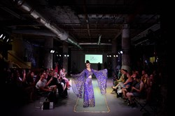 A model wearing a design by Stephanie Moye walks the runway during the inaugural Fashion Week Downtown fashion show, put on by the Pittsburgh Downtown Community Development Corp, at the Union Trust Building in Downtown Pittsburgh in 2016. The event returns Sept. 18-22.