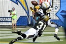 Chargers wide receiver Travis Benjamin makes a touchdown catch as Jacksonville's cornerback Davon House defends Sunday.