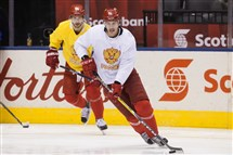 Russia's Evgeni Malkin, right, and Nikita Kucherov skate during practice at the World Cup of Hockey in Toronto.