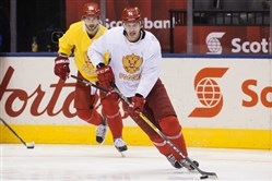 Russia's Evgeni Malkin, right, and Nikita Kucherov skate during World Cup of Hockey practice Friday.