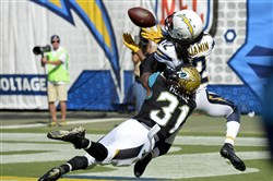Jaguars cornerback Davon House defends Chargers receiver Travis Benjamin during a game in September.